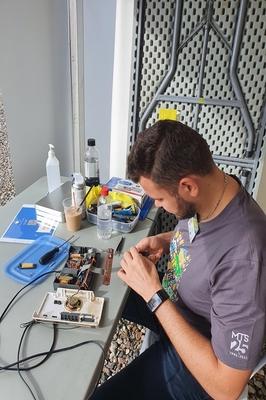 Alain repairing a radio